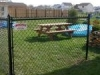 Black vinyl chain link fence services